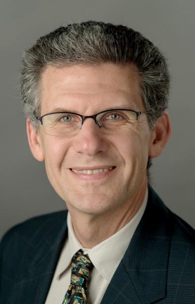 Dr. Derek Kauneckis
