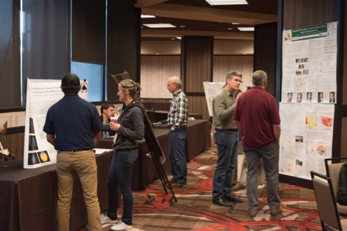 Students and researchers network during a poster session at the 2017 Tribal Summit.