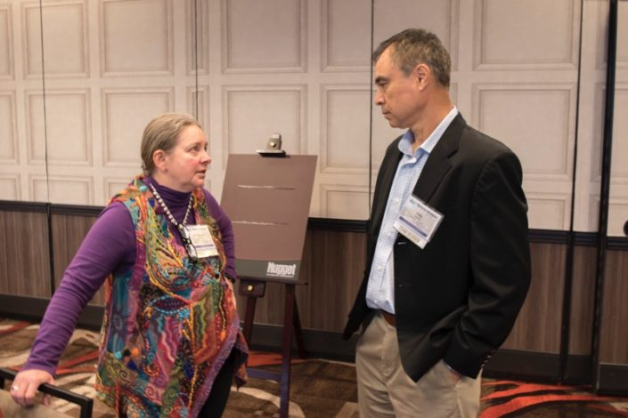NWAL project director Maureen McCarthy talks with NWAL team member John Phillips