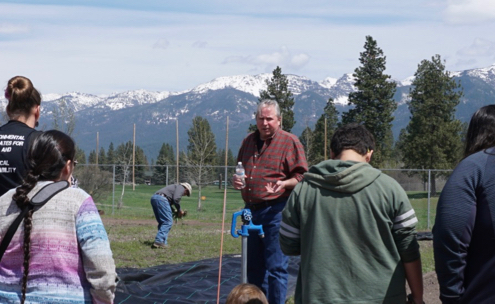 Virgil Dupuis, Extension Director for Salish Kootenai College, speaks with high school students in the college garden at NWAL Youth Day. May 3, 2018.